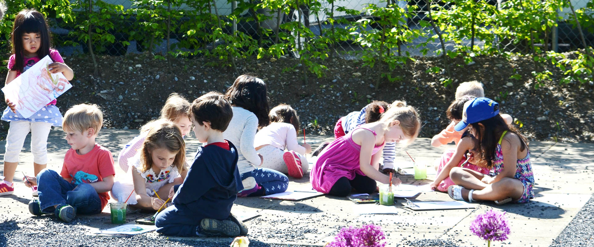 preschool/kindergarten/early years students painting in the research garden, international school