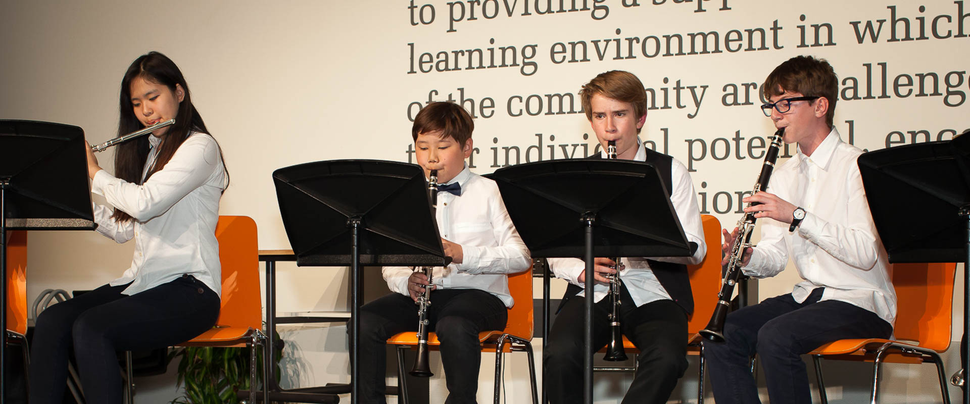 music students performing in a music concert, international school