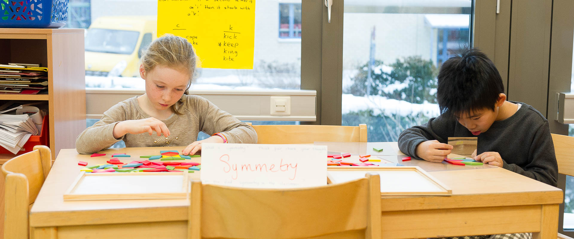 students learning about symmetry, international school