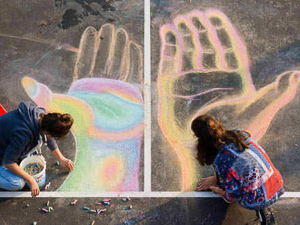 round square students drawing a peace mural on the campus grounds on international day of peace, international school
