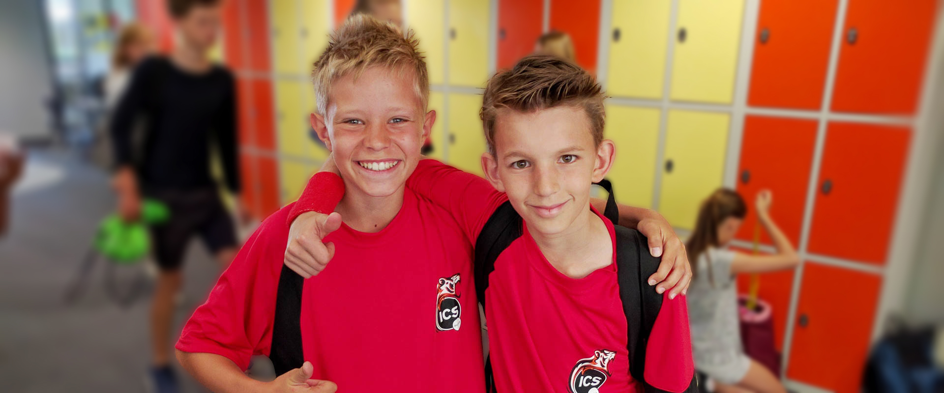 two students wearing house t-shirts, international school