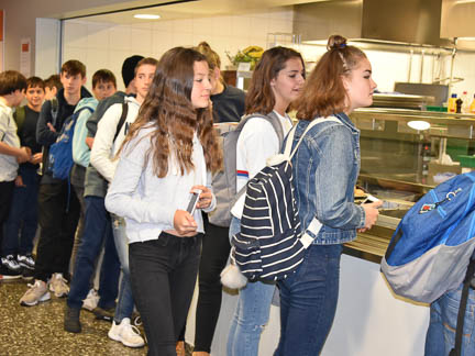 students in the school cafeteria, international school
